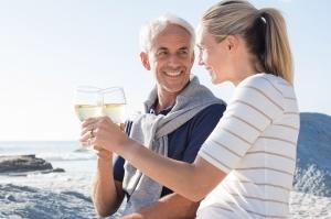 Mature couple raising toast