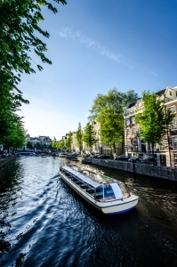 Cruise Boat In Amsterdam Canal