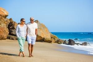 Senior African American couple walking on beach